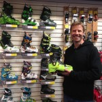 Glenn Delboscoe, boot fitter, standing in front of the boot wall in a ski shop