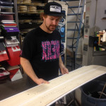 Matt showing off the wooden core of the Prior Snowboards