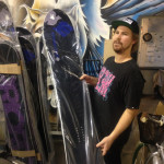 Matt holding a Prior snowboard with NEH graphics packed in plastic ready to ship
