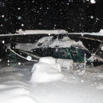 Clearing the helicopter off during the snow storm