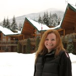 Simone Mattner smiles in front of Yellow Cedar Lodge. She is excited bout the lodge renovations.