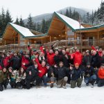 Group staff photo in front of Yellow Cedar Lodge. We Are Back!