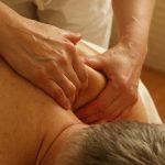 Massaging a heli skiers shoulder.