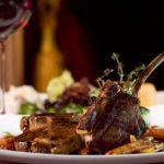 Gourmet heli-skiing meal, rack of lamb dinner.