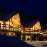 Front of Yellow Ski Lodge Lit Up at Night