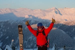 Thumbs Up Heli Skier on Mountaintop in BC Canada