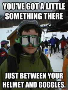Image of Skier in Googles Near Mountain Chair Lift