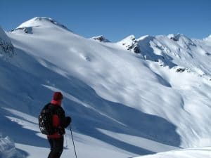 Heli Skier Looking Out Over the Skeena Mountain Range in BC Canada