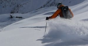 Heli Skier Cutting Thru Untracked Powder in BC Canada