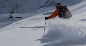Heli Skier Cutting Thru Untracked Powder in BC Canada