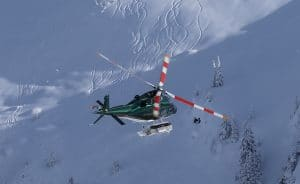 Helicopter Carries Heli Skiers Up the Mountain in BC Canada